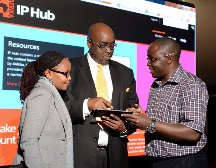 Louis Otieno, Corporate Affairs Director, Afrika Initiative; Microsoft Corporation (Centre) taking Juliana Rotich, Executive Director of Ushahidi (Left) and Gabriel Mranda, Director, Mranda Technologies through the features of the Microsoft IP Hub