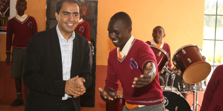 Airtel CEO Adil El Youssefi dances with one of the children of I-Afrika Centre