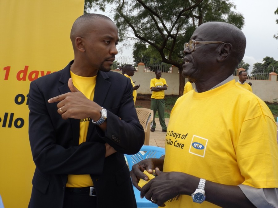 MTN CEO Philip Besiimire listens to Comboni Secondary School Headmaster Christopher Mogga about the challenges facing the school, one of the oldest started by the Comboni Missionaries