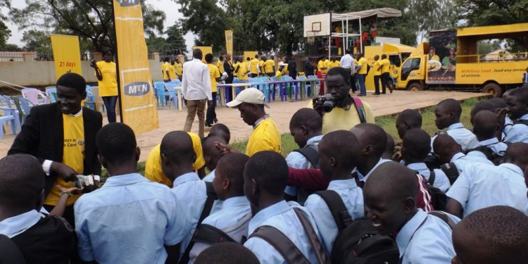 MTN staff distributes water purification tablets