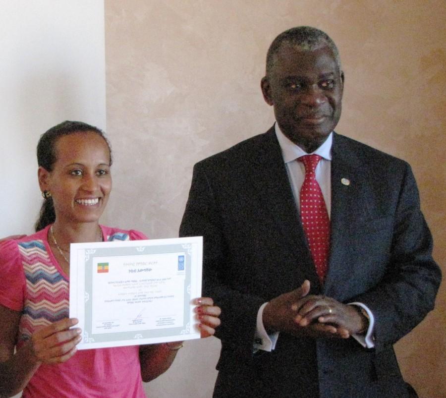 Eugene Owusu with a graduate