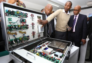 Samsung's Ken Gitonga (centre) explains to Samsung Electronics East Africa VP Robert Ngeru and Industrialisation CS Adan Mohamed how an AC unit works during the launch of Samsung's AC Class TUK