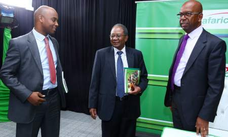 Safaricom CEO, Bob Collymore, Chairman, Board of Directors, Nicholas Nganga and Steve Chege, Director of Corporate Affairs during the release of Safaricom Limited Annual Report held at the Bomas of Kenya.
