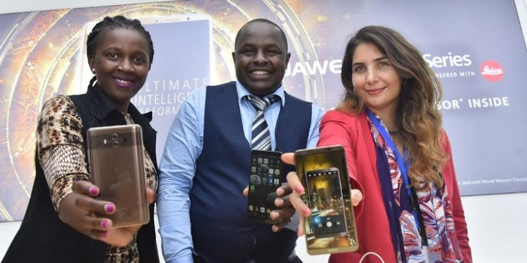 Nakhulo Khaimia, Marketing Manager Huawei Device, Derrick Alenga, Retail Manager Huawei Kenya and Sanaz Abaie Head of Category for Mobile and Tablets Jumia Kenya showcase the Huawei Mate 10 series during its launch in the Kenyan market.