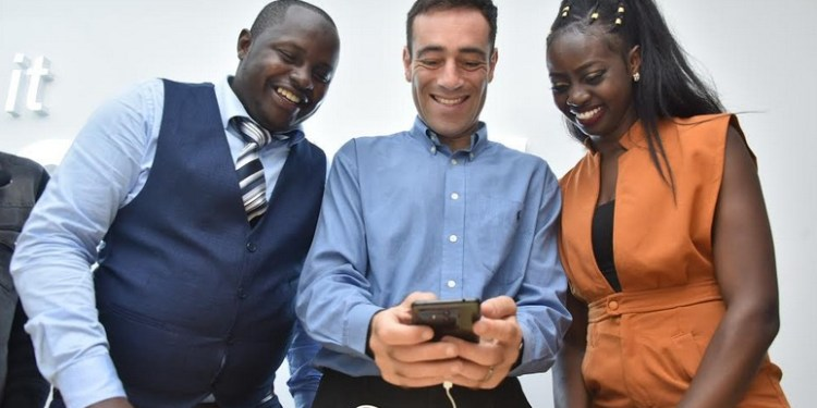 Derrick Aelnga, Retail Manager Huawei Kenya, Adam Lane Senior Director Public Affairs Huawei and Velma Delila use the Huawei Mate 10 Phone during the launch of the Mate 10 series into the Kenyan market.