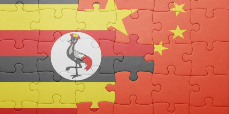 puzzle with the national flag of china and uganda . concept - nbn.media