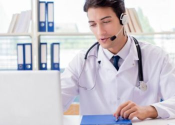 Young male doctor in telehealth concept