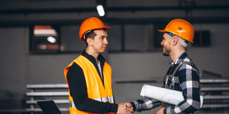 Two colleagues at a factory