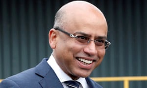 Liberty Steel's Sanjeev Gupta smiles outside its processing mill in Dalzell, Scotland, in 2016.