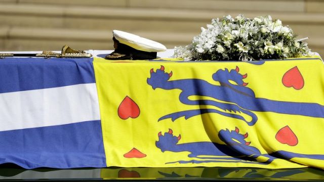 The Duke of Edinburgh's coffin, covered with His Royal Highness's Personal Standard on The Land Rover Defender outside St George's Chapel, Windsor Castle, Berkshire, during the funeral of the Duke of Edinburgh. Picture date: Saturday April 17, 2021.