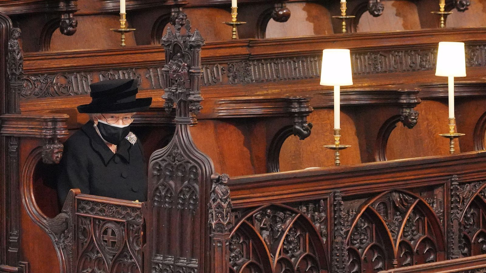 Britain's Queen Elizabeth II takes her seat for the funeral of Britain's Prince Philip, who died at the age of 99, at St George's Chapel, in Windsor, Britain, April 17, 2021. Victoria Jones/Pool via REUTERS