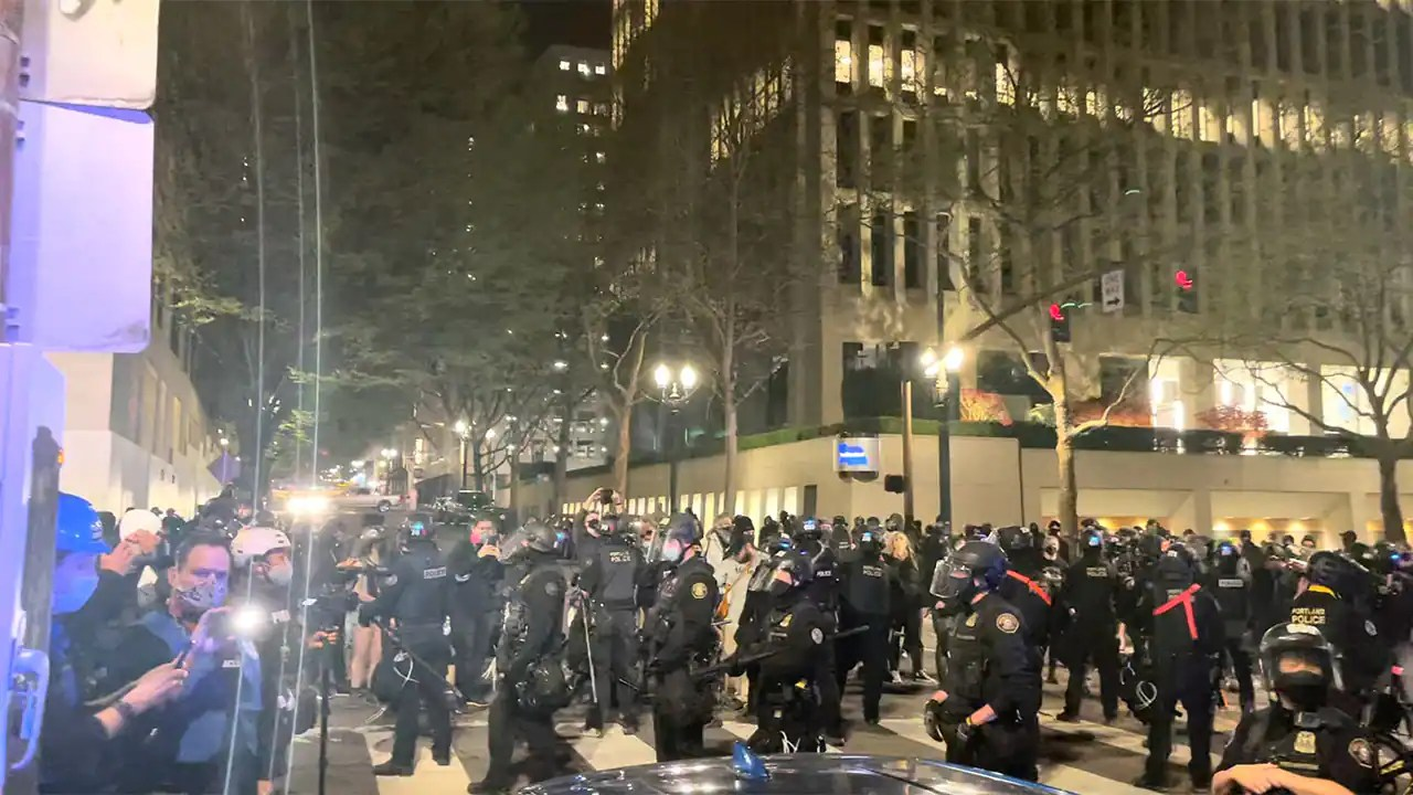 Riot declared in Portland after protesters cause damage following police shootings