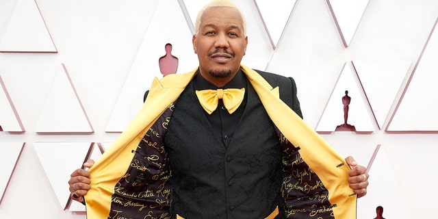 Travon Free attends the 93rd Annual Academy Awards on April 25. He wore a Dolce & Gabbana suit lined with the names of those killed by police brutality in the United States.