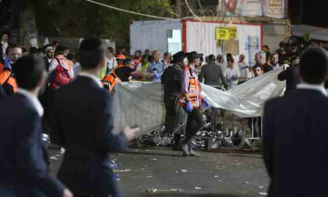 Israeli security officials and rescuers inspect the dead bodies of dozens of Ultra-Orthodox Jews who died in a crush during Lag Ba'Omer in Mount Meron
