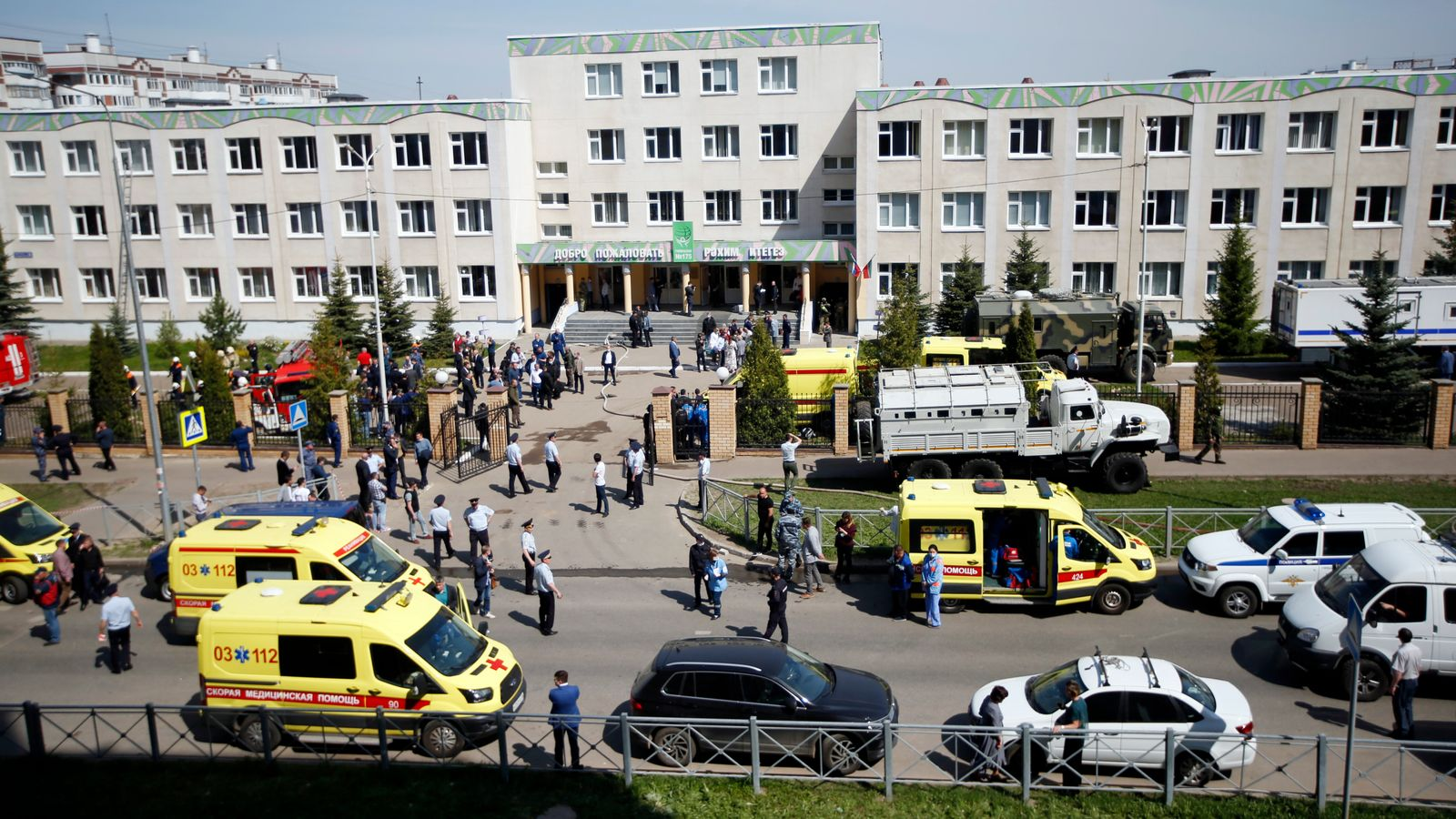 Police and emergency services at the scene of the school shooting in Kazan, Russia, as students are evacuated. Pic: AP