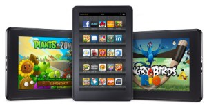 The Kindle Fire in portrait and landscape, showing a list of apps and a sample of the Angry Birds Game