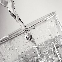Water pouring into a glass (Greg Riegler/Flickr)