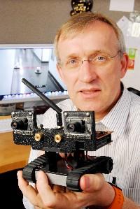 Henrik Christensen holding a robotic vehicle (Gary Meek, Georgia Tech)