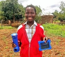 African boyholding Lifelight by Lifeline Energy