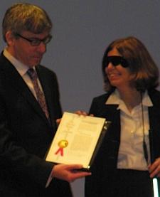 Robert Greenberg and Barbara Campbell hold U.S. patent no. 8 million (A. Kotok)