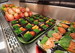 fruits and vegetables on lunch trays