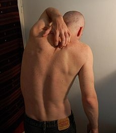 Man scratching his back