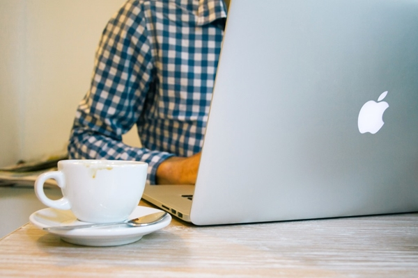 Apple laptop and coffee