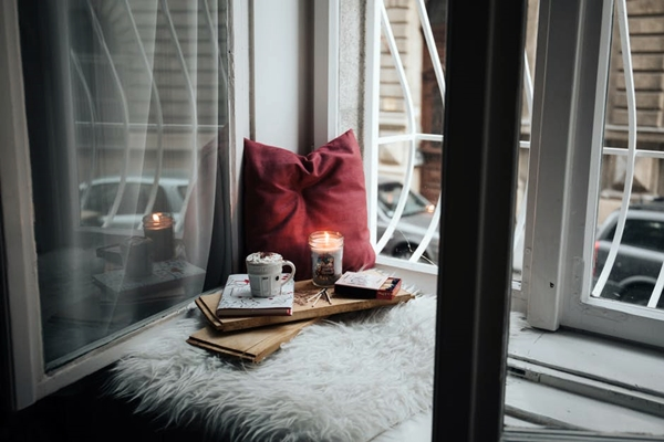 Pillow by window