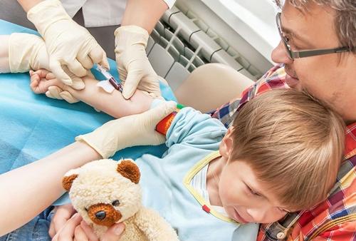 Boy giving blood sample