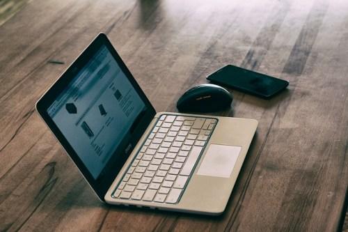 Laptop on wood desk