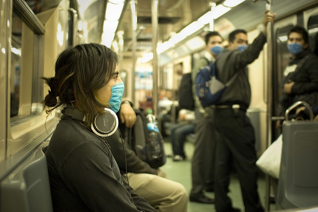 Train pssengers in masks
