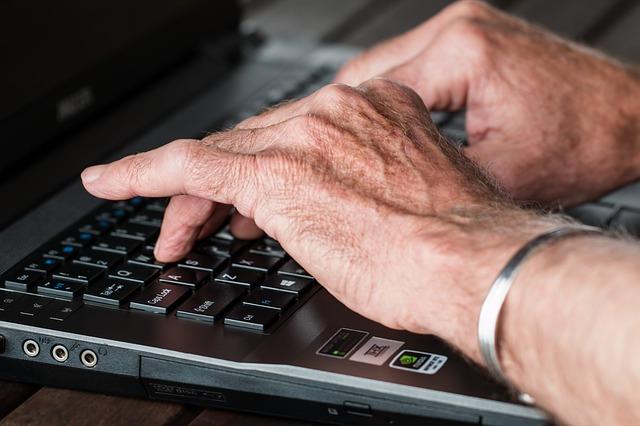 Older hands on keyboard