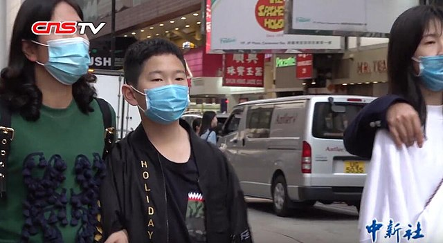 Hong Kong residents in masks