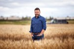 Curtis Pozniak in wheat field