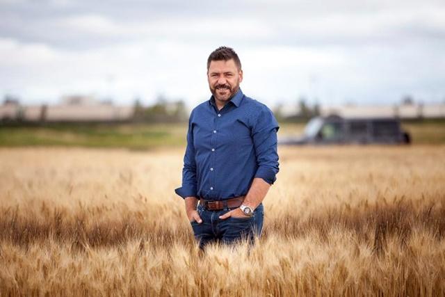 Curtis Pozniak in wheat field