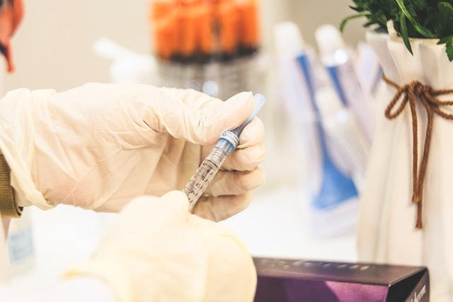 Syringe in hand