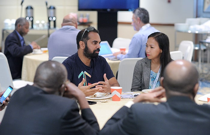 Shiva Bissessar discusses digital currency with Bloomberg correspondent Lien Hoang, during LAC working lunch (Image courtesy: ICANNphoto)