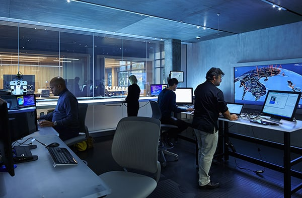 Members of the Microsoft Digital Crimes Unit work in a forensics lab in the Cybercrime Center. Photo courtesy Microsoft.
