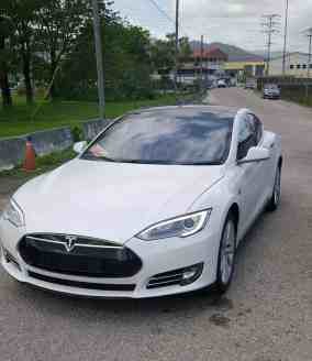 The Tesla Model S on the road in T&T under demonstration plates. Photograph by Ian Smart, courtesy Smart Energy.