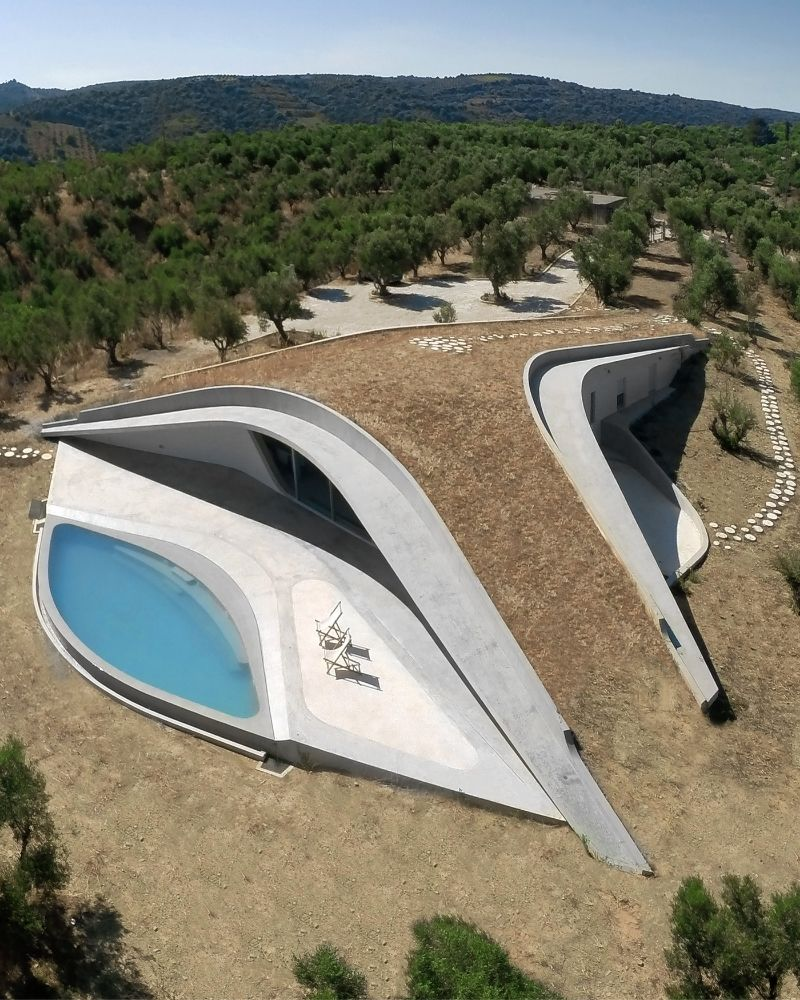 an outdoor shaped pool to contemporary home