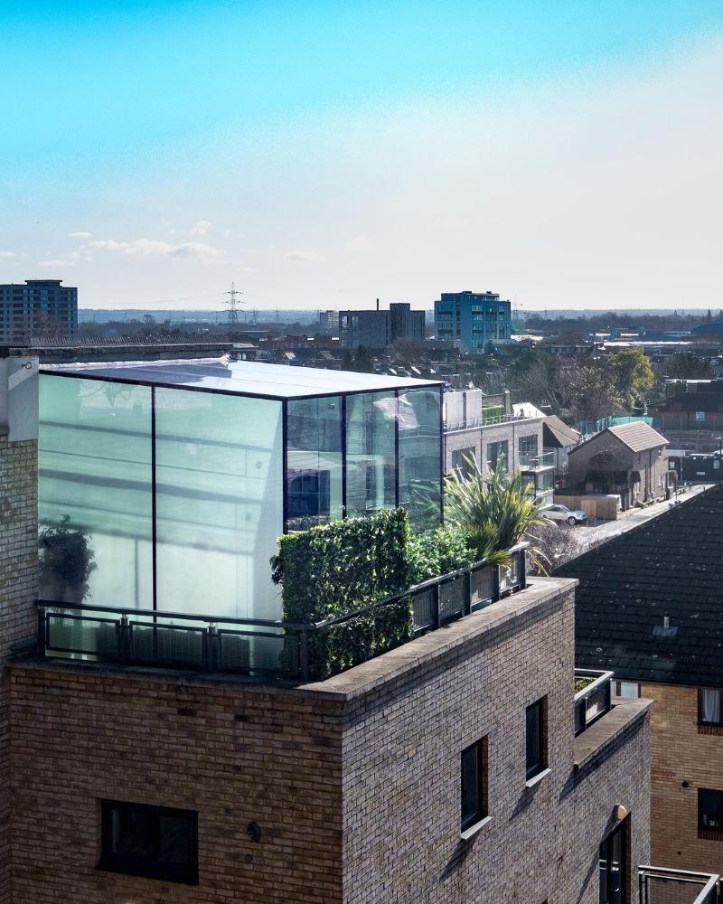 a rooftop glass box with solar control glazing
