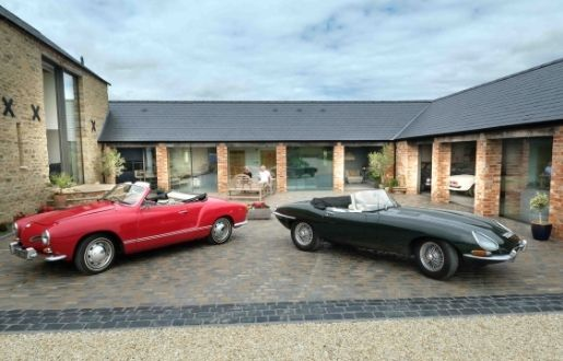 luxury cars on display in a residential glazed garage with flush thresholds