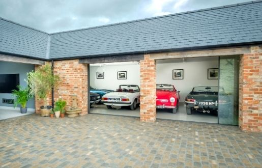 luxury residential car garage with large sliding glass door
