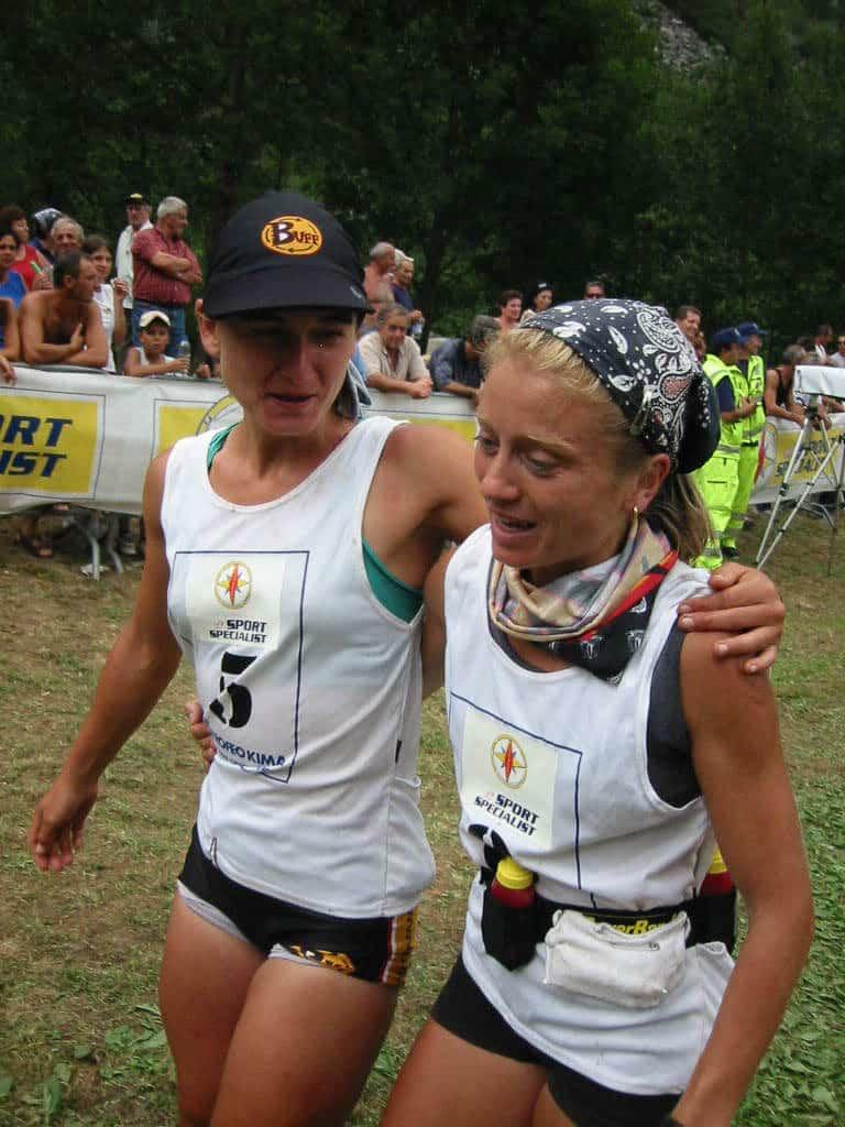A portrait side shot of two women walking together. It seems to be shortly after crossing the finish line of a trail run. The one on the left is wearing a Cap Buff®. The one on the right is wearing two High UV Buff®. One as neck cooler & one as alice band. The seem both tired and happy.