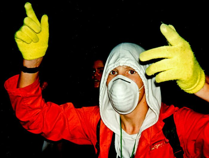 90s raver in mask outfit and gloves