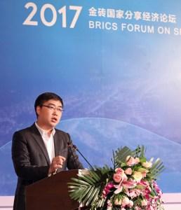 Didi founder Cheng Wei speaking at the BRICS Sharing Economy Forum in Beijing (Image credit: BRICS Forum)