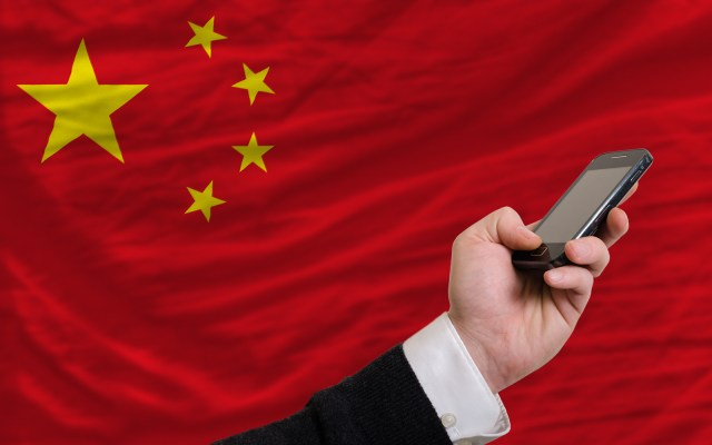 bigstock Cell Phone In Front National 43674526 • Insights   Why Chinese tech giants are becoming very generous Alibaba, Features, government, meituan, Premium, Tencent, With Chinese Characteristics