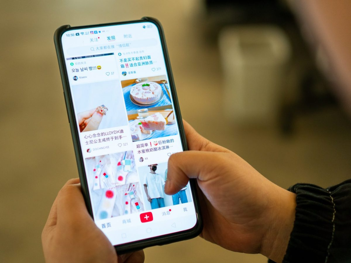 A user browses the Xiaohongshu app. (Image credit: TechNode/Eugene Tang)