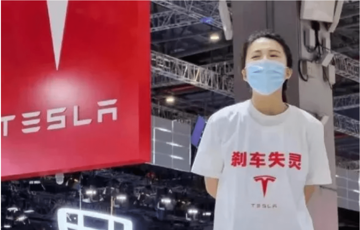 tesla new energy vehicles electric cars china government auto shanghai show protest