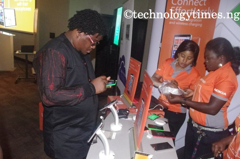 A customer admires smartphone on display at a Nokia Lumia show in Lagos